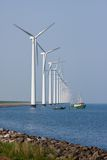 Windturbines in the Netherlands with fishing ship Royalty Free Stock Images