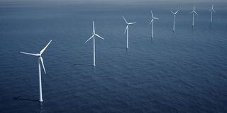 Windturbines on the ocean Stock Photos