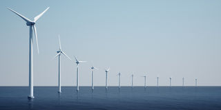 Windturbines on the ocean Stock Images