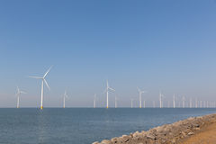 Windturbines  in the water producing alternative energy Royalty Free Stock Images