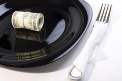 Windungen der Dollar auf einer Platte Lizenzfreie Stockfotografie