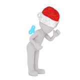 Windup clockwork 3d figure in a Christmas hat Royalty Free Stock Photography