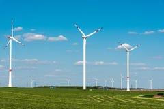 Windwheels in a grass field in Germany Royalty Free Stock Photo