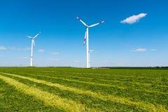 Windwheels in a mowed field Royalty Free Stock Image