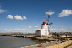 Windwill. At the salt ponds near Trapani in Sicily Royalty Free Stock Images