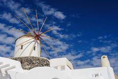 Windwill of Oia Santorini, Greece, copyspace. View of Oia windmill at the Island Santorini, Greece. Lot of copyspace Stock Image
