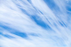 Windy clouds on blue sky. Background photo texture Stock Images