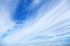 Windy clouds on the blue sky. Background texture Royalty Free Stock Photo