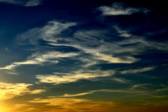 Windy clouds and vapor trail 2 Stock Images