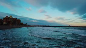 View from above during sunset on Mediterranean sea coast near Valencia. Windy and colorful evening in Spain. Filmed on beach without people near Valencia stock video footage