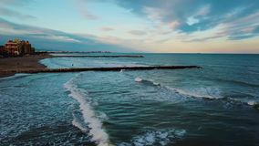 View from above during sunset on Mediterranean sea coast near Valencia. Windy and colorful evening in Spain. Filmed on beach without people near Valencia stock video