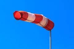 Windy conditions. Wind sock against blue skies in windy conditions Royalty Free Stock Photo