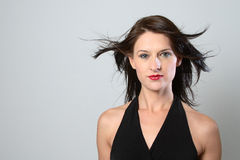 Windy dark hair woman Royalty Free Stock Image