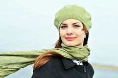 Windy day. Attractive teenage girl wearing beret standing outdoors in windy day Royalty Free Stock Images