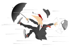 Windy day. Man caught up by the wind, is trying to keep the umbrella and bag Stock Image
