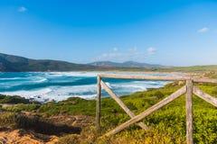 Windy day in Porto Ferro shore Stock Photography