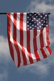 Windy days in america. American flag on the blue sky background Royalty Free Stock Images