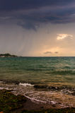 Windy Evening Shoreline. Shoreline by the Marmara sea of the country Turkey in a windy evening with changing cloud formations and glow of the setting sun behind Royalty Free Stock Photo