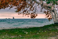 A windy fall day on Mackinac Island, looking out at Round Island lighthouse. A windy fall day on Mackinac Island, looking out at Round Island lighthouse, with a royalty free stock photos