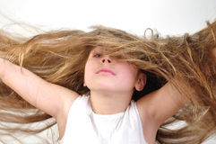 Windy hair. Girl with long windy hair royalty free stock images