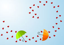 Windy Hearts and Umbrellas Valentines Day Card. Wind blowing hearts and umbrellas with copy space to write and sunlight Royalty Free Stock Photo