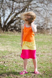 Windy. Little girl on a very windy day Stock Photography
