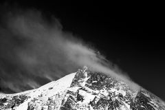 Windy mountain lanscape after a recent snow day. Black and white stock photo