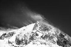 Windy mountain lanscape after a recent snow day. Black and white stock photography