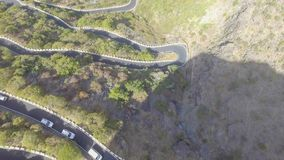 Windy mountain road, aerial view stock photos