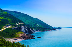 Windy Mountain Road. Photo of a beautiful Mountain road beside the ocean stock images