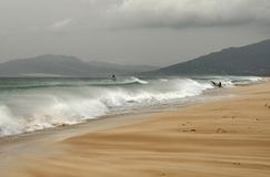 Windy ocean Tarifa Spain. Los Lances beach in Tarifa Southern Spain Europe. Waves approaching the coast on cloudy day. Windy climate makes ideal conditions for royalty free stock photos