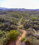Windy path shot from above. Curved hiking trail taken from atop a water tower Stock Photography