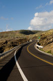 Windy road. A windy road through the mountains with blue sky Stock Photos