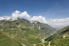 Windy road among high green mountains Royalty Free Stock Images