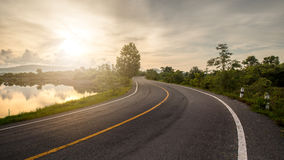 Windy road and sunrise Royalty Free Stock Photo