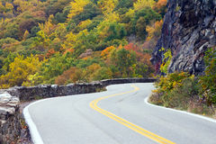 Windy Road to Colorful Fall Forest Royalty Free Stock Image