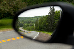 Windy Roads in Cape Breton. The view of windy roads in Cape Breton when viewed from a car wing mirror Stock Images