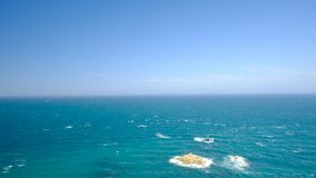 Windy sea view with incoming waves hitting the coast of Bretagne in France. During a beautiful summer day stock footage