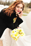 Windy spring day. Pretty girl with daffodils in windy spring day stock images