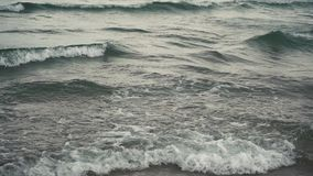 Windy stormy sea surface waves. Windy stormy sea surface on sunset stock footage