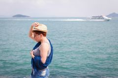 Windy summer days relaxing on coast feeling good. adult woman in royalty free stock image