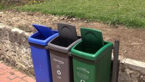 Windy, Trash Cans, Garbage, Recycling. Stock video of trash cans stock video