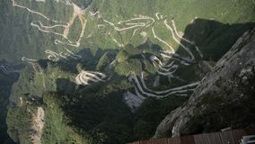 Windy 99 Turn Road. View of long windy 99 turn road going up to summit of Tianmen shan in the city of Zhangjiajie in Hunan province China on a sunny summer day stock footage