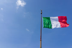 Windy waving Italy flag with blue sky Royalty Free Stock Photos