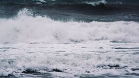 Windy weather big stormy sea waves. Slow Motion. Ocean Waves During a Storm. Powerful Sea Tropical Hurricane. Global