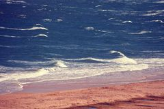 Windy weather in the sea. Deserted beach, seashore, waves on the sea. Windy weather in the sea Royalty Free Stock Photography