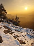 Windy winter morning view to East with orange sunrise. Daybreak in rocks. Winter morning view to East with orange sunrise. Daybreak in rocks of Bohemian-Saxon Royalty Free Stock Photography