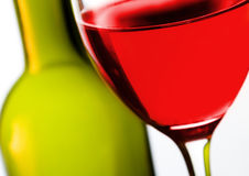Wine. Glass of red wine with  bottle in background Stock Photos