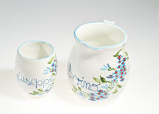 Wine. Decorated pitcher and glasses on a white background Royalty Free Stock Photography