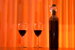 Red wine bottle with two glasses Stock Image
